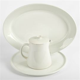 Vintage Arabia of Finland White China Tableware: A group of vintage Arabia of Finland white china tableware. Includes a teapot designed by Kaj Franck for the Kilta line. Stamped to the base with the Arabia mark and number 117 with a faint mold mark 3A. Joined by an oval serving platter with stamped maker's stamp and 11-57 and mold mark DD 43cm; and a round serving platter stamped with maker's mark and 5-64.