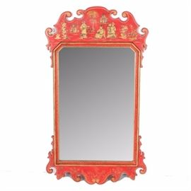 Hand-Painted Asian Inspired Mirror: An Asian inspired wood wall mirror. This red mirror features scrolled edges to the top and the bottom with hand-painted gold tone accents to the wooden frame. There is an attached wire to the verso.