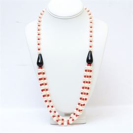 Pearl, Onyx, and Coral Necklace: A pearl, onyx, and coral necklace.