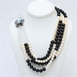 Pearl, Onyx, and Pearl Necklace: A pearl, onyx, and mother of pearl multi-strand necklace.