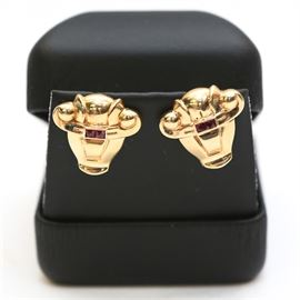 14K Gold Bull Head Earrings with Garnets: A pair of 14K gold bull head earrings with garnets.