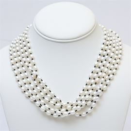 Pearl and Onyx Necklace: A multi-strand freshwater cultured pearl and onyx necklace.