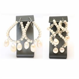 Pairs of Pearl Earrings: A pairing of pearl earrings. Included are two pairs of freshwater pearl dangle earrings. Both earrings feature various sizes of freshwater pearls and silver tone metal hooks.
