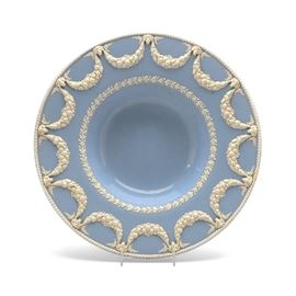 Wedgwood Dish: A large Wedgwood Jasperware blue dish, decorated with raised white porcelain laurel leaf motif and fruit swags interspersed with ram heads to edge. Stamped Wedgwood to the underside.