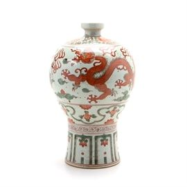 Chinese Decorative Qilin Hand Painted Vase: An early to mid 20th-century Chinese hand painted qilin stoneware vase. This vase features hand painted red floral medallions to the top and two qilin figures with flames. Qilin are chimeric creatures of Chinese myth that were believed to be omens of good fortune. The vase is unmarked.