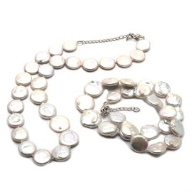 Lucas Lameth Sterling Cultured Coin Pearl Necklaces: A pair of cultured coin pearl necklaces with sterling silver findings including extender chains and Lucas Lameth stamped hang tags.