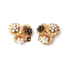 14K Yellow Gold Diamond and Pearl Earrings: A pair of 14K yellow gold diamond and pearl clip back earrings.