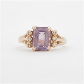 14K Yellow Gold Amethyst and Diamond Ring: A 14K yellow gold amethyst and diamond ring. The diamonds are of fair quality.
