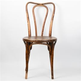 "Austrian Antique Thonet Style Bentwood Chair: An Austrian antique Thonet style bentwood chair. This chair features bentwood legs and backrest with arched leg supports and a round seat with wooden, steam-pressed floral motif. One side of the seat bears a mark for ""Jo. J. Kohk"" followed by an indiscernible word and ""Austria""."