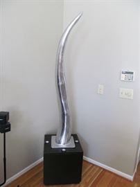 """Aluminum """"Horn"""" sculpture with lighted base"""