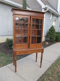 Antique plantation desk with glass-paned doors
