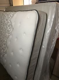 Queen mattress.....Mattress is brand new but boxspring has 1 wooden slate that is split but it is still very usable.