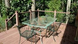 Metal Patio Set with wire chairs and glass topped rectangle table