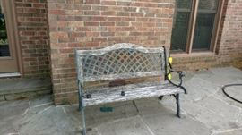 Metal backed and accented wooden bench