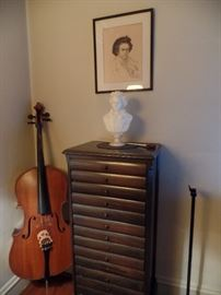 Music cabinet, cello and Bach