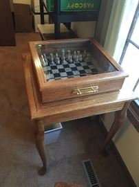 oak chess table with glass top cover and chess pieces