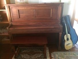 ANTIQUE AUTOTUNE PLAYER PIANO IN WORKING ORDER.  NEEDS TUNING AND HAS LOTS OF MUSIC ROLLS!