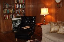 Vinyl chair and ottoman, books