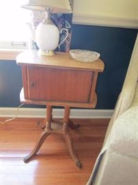 Smoking table with lined compartment