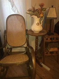 Oak rocker with cane back and bottom. oak plant stand and oak primitive step ladder that folds to an iron board