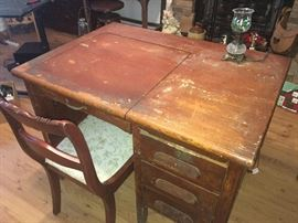 very old typing table with three drawers on right side