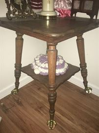 oak table with glass ball and brass claw feet