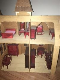 inside back of wood doll house with miniature doll furniture. great condition!