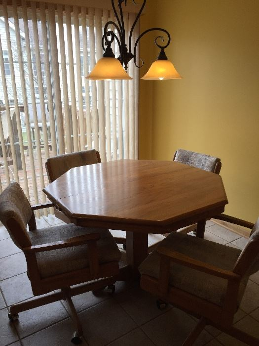 kitchen table with 4 rolling chairs and extension leaf