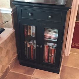 Black wooden cabinet with two glass doors