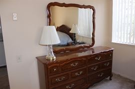 Six drawer chest and mirror.
