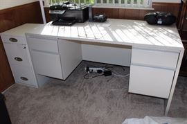 White desk and filing cabinet.