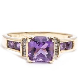 10K Gold Amethyst and Diamond Ring: A 10K Gold Amethyst and Diamond Ring.