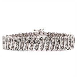 Sterling Silver Bracelet with Diamonds: A sterling silver bracelet with diamonds.