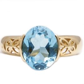 14K Gold Ring with Blue Topaz: A 14K gold ring with blue topaz.