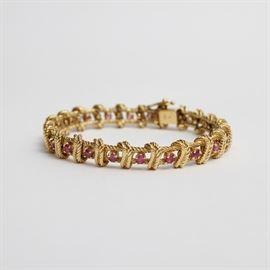Vintage Tiffany & Co. 18K Gold Garnet Bracelet: An 18K gold Tiffany & Co. bracelet. This bracelet features a prong set garnet on each cable design link. Comes in the original vintage Tiffany & Co. snap hinge velvet box.