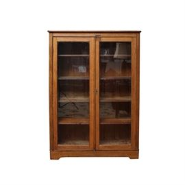 Early 20th Century Larkin Soap Co. Oak Display Cabinet: An antique Larkin Soap Co. display cabinet. This early 20th century piece features oak construction with five interior shelves behind two glass doors. The back has a Larkin Soap Co. inspector's seal.