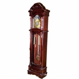 Contemporary Grandfather Clock: A contemporary grandfather clock. The mahogany case features a curved arch pediment, column details, and brass-toned hardware. The clock features hemispheric globes design above its classical clock face design, which has silver tone Roman numerals over a brass-tone base surrounded by ornate silver-tone framing. The clock is unmarked.
