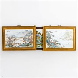 Collection of Chinese Paintings on Ceramic Tile: A collection of Chinese paintings on ceramic tile. This collection features a painting depicting figures fishing on a river flanked by mountains, trees with three larger ships in the distance, A painting depicting a lone figure with cattle crossing a bridge with mist covered mountains in the background, and a painting depicting ducks in a pond with waterlilies and flowers. All of the pieces are marked on the top right or left and set in wood frames.