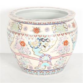 East Asian Planter Pot: An East Asian planter pot. The piece depicts scenes of florals and intricate designs throughout in a palette of red, blue, black and more against a white backing. The interior depicts aquatic plant life and koi fish and the underside is stamped with a red four character mark.