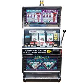Double Double Diamond Slot Machine: An IGT Double Double Diamond slot machine. This currency operated machine has three reels, button play, and a legacy lever on the right side. Model B5036CFIW, serial 469202, manufactured 6/94.