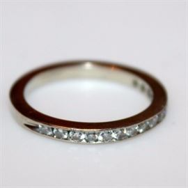 14K White Gold and Diamond Ring: A white gold and diamond band.