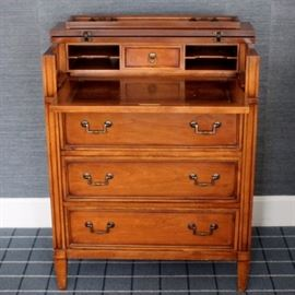 Vintage Secretary Desk: A fine vintage cherry secretary desk, with three dresser-style drawers and a hinged top which looks like a fourth drawer, but folds up on hinges to reveal the desktop. Desk includes sliding extendable writing surface with leather inlay, a small center drawer, and several pigeon holes and letter slots. The piece features dovetail joining and carved columnar accents.