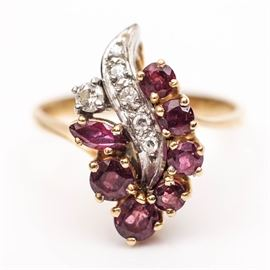 """14K Gold, Diamond and Ruby Cocktail Ring: A women's 14K yellow gold ring with pink and white stones held in prongs. The ring comes with a small presentation box marked """"Syman Bros."""""""
