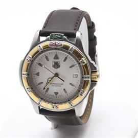 """Tag Heuer Men's Wristwatch: A Tag Heuer men's wristwatch. This watch features a white dial under a sapphire crystal with triangle and dash hour indicators, gold tone hands, a digital calendar window and is marked on the dial, """"Tag Heuer, Professional 200 Meters, Swiss Made""""."""