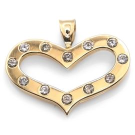 14K Yellow Gold and Diamond Heart-Shaped Pendant: A 14K yellow gold and diamond heart-shaped pendant.
