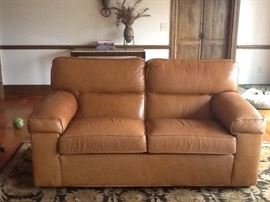 "Ethan Allen love seat British tan leather 6 feet long by 37""deep and 37"" high"
