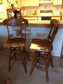 Pair of oak swivel bar stools