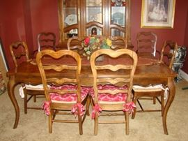 Dining room table with 8 chairs and 2 leaves.  Matching cabinet available.