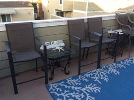 many sets of bar height tables and chairs as well as wrought iron side tables