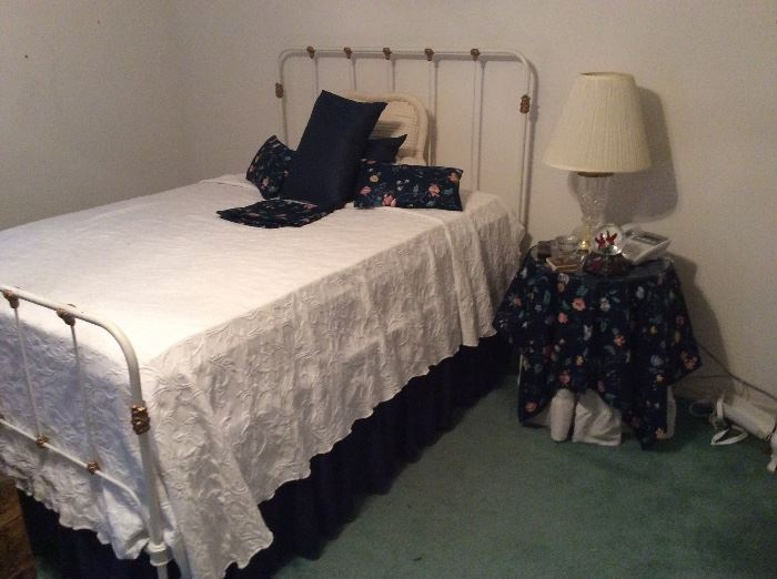 Full bed - vintage metal bed frame with matching pillows & side table with matching tablecloth.   Nice crystal lamp.